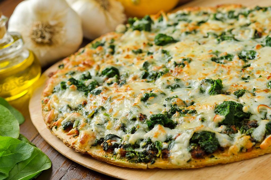 Pizza de espinacas con queso de cabra